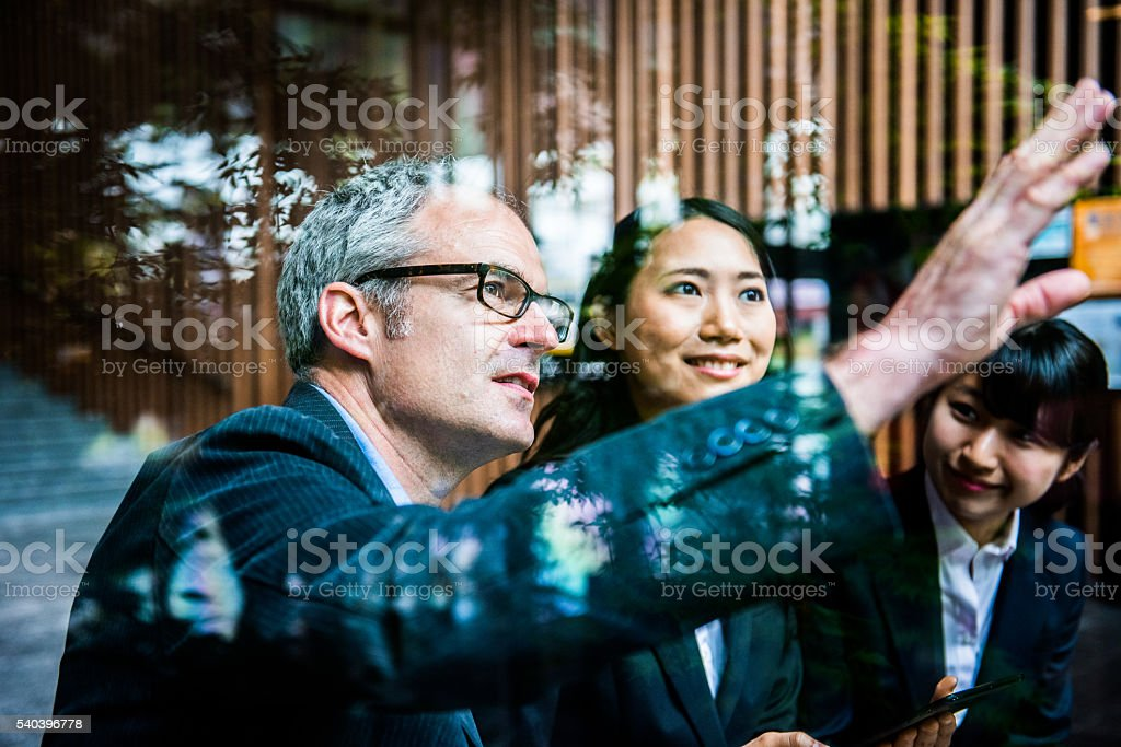 Englishman discussing concept with Japanese team stock photo