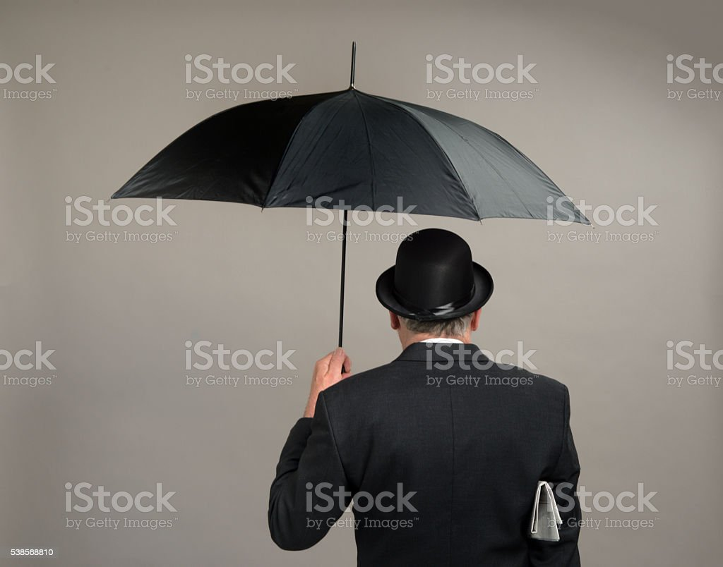 Englishman with bowler hat and umbrella stock photo