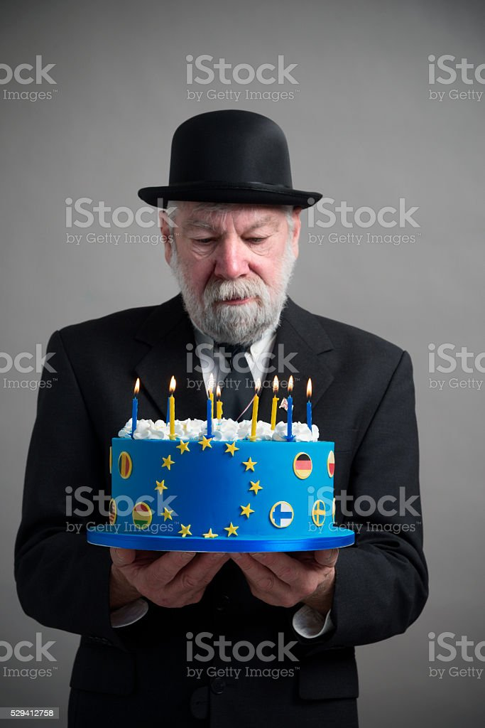 Englishman with bowler hat with EU cake with candles stock photo