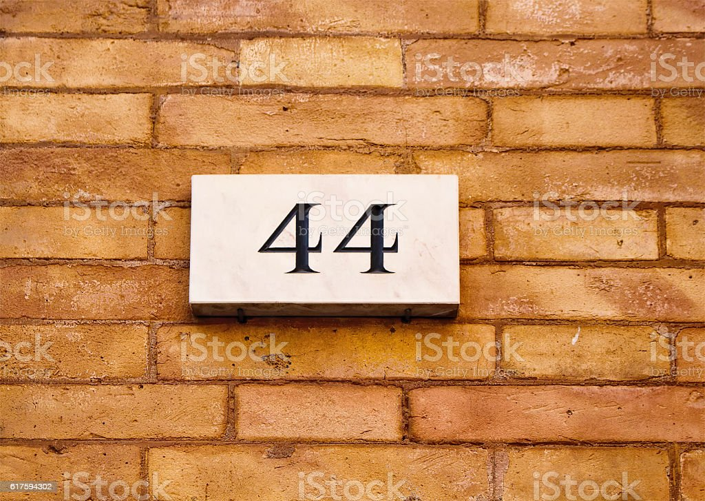 Engraved building number stock photo