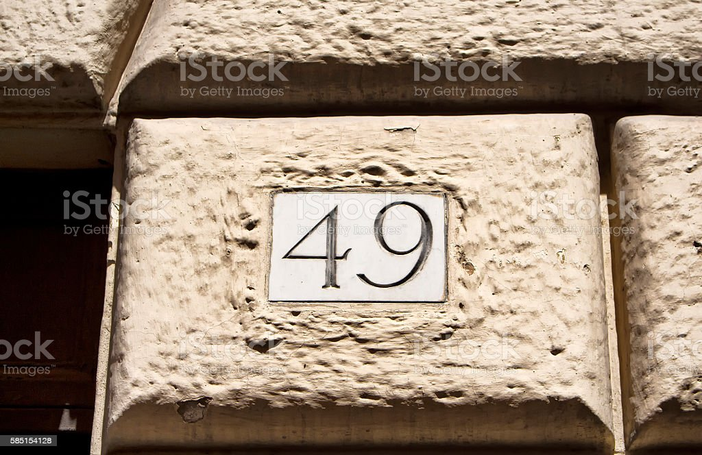 Engraved old building number 49 in Rome stock photo