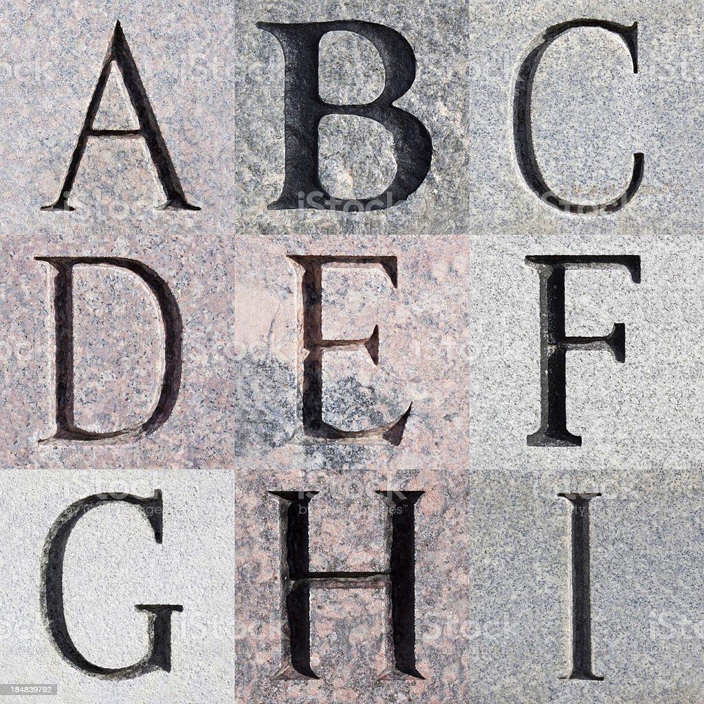 Engraved Stone Alphabet Series stock photo