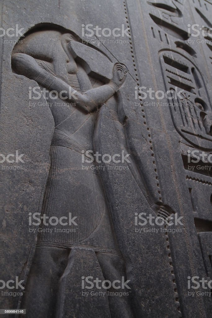 Engraving of God Thoth in Egyptian remple. stock photo