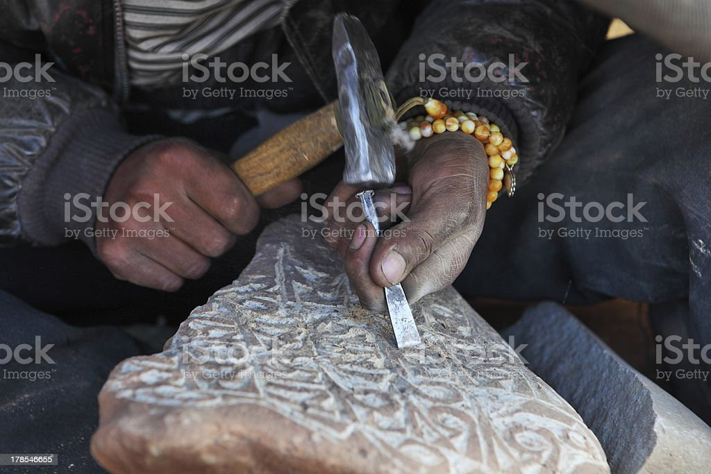 Engraving Tibetan Buddhist Mani Stones stock photo