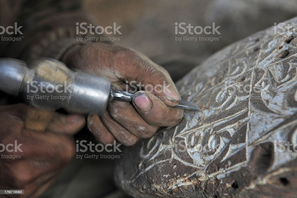 Engraving Tibetan Buddhist Mani Stones royalty-free stock photo