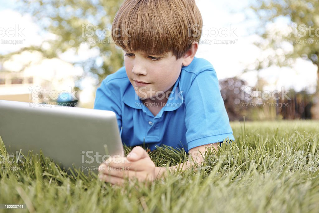 Engrossed in modern technology royalty-free stock photo