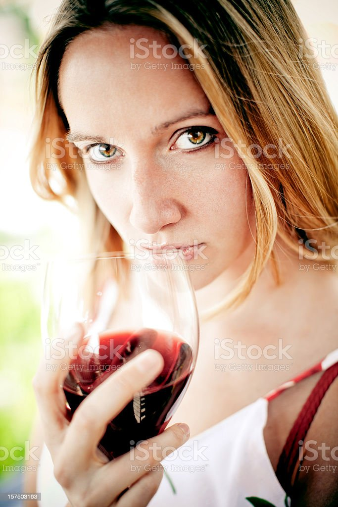 Enjoing a glass of red wine royalty-free stock photo