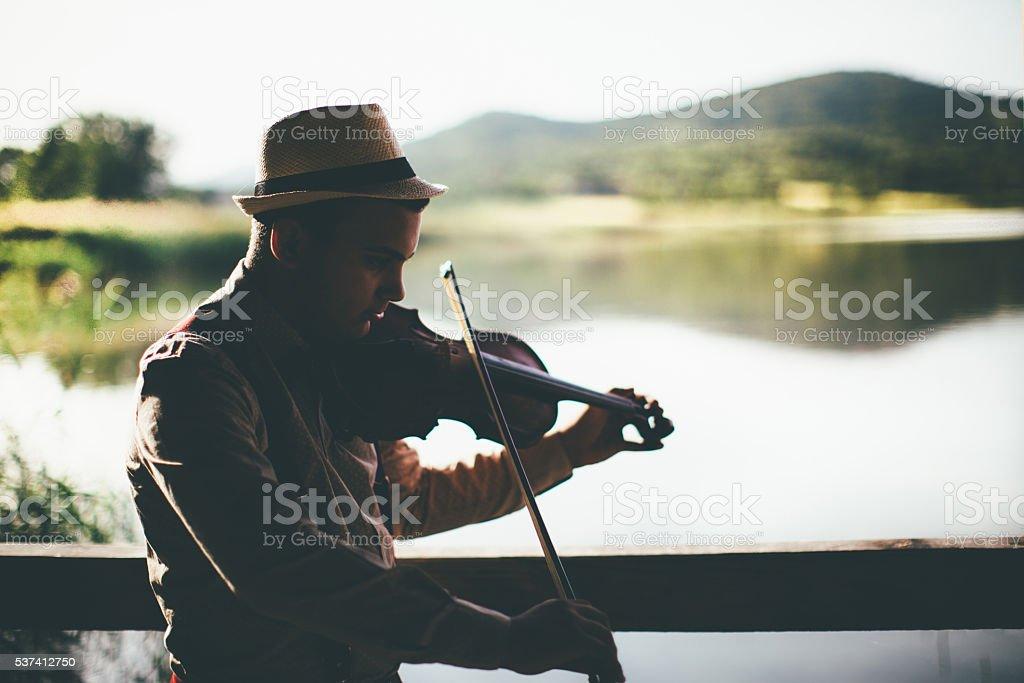 Enjoy making music in nature stock photo