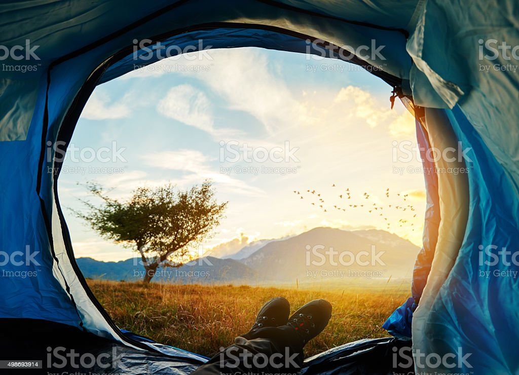 enjoy sunset in my tent stock photo