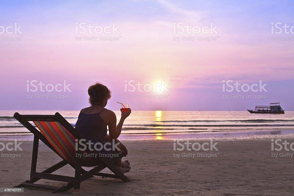 enjoy sunset on the beach stock photo