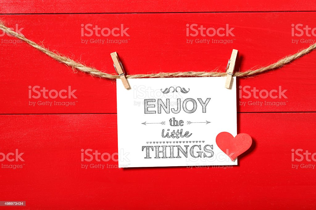 Enjoy the Little Things message with clothespins stock photo