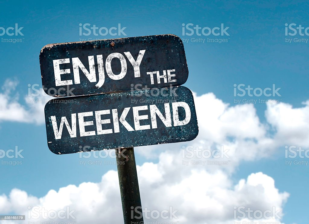 Enjoy the Weekend sign with clouds and sky background stock photo