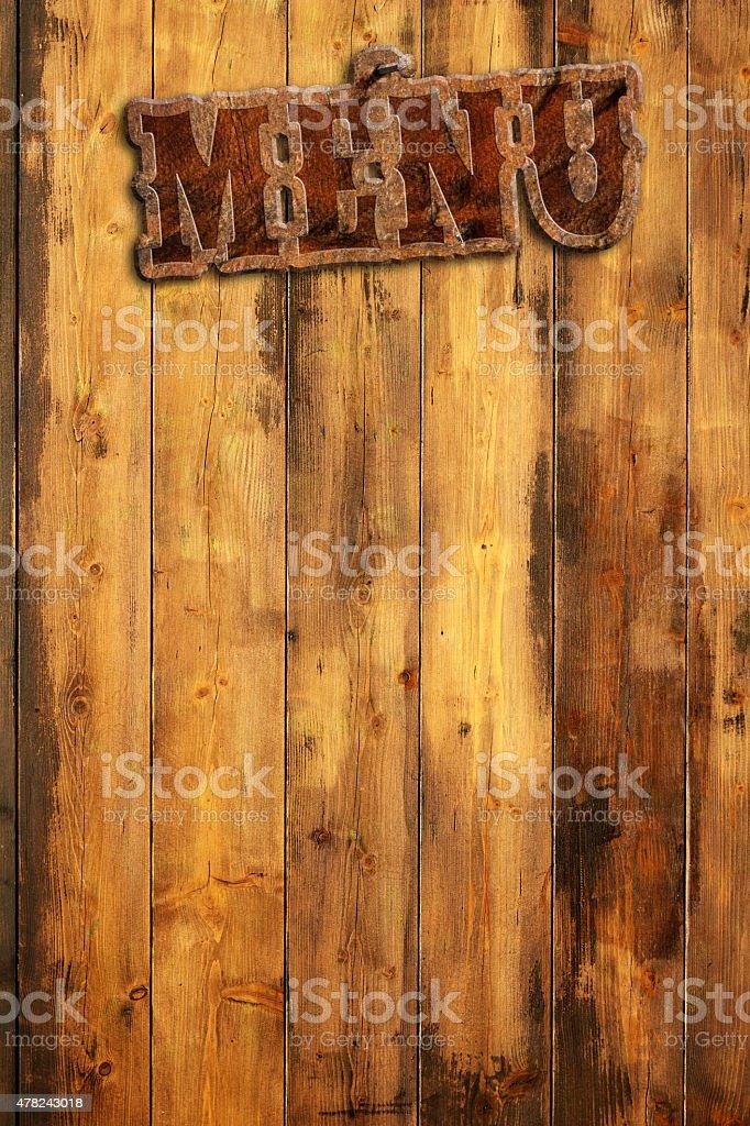 plague \'menu\' hanging by a wooden wall