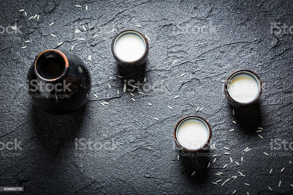 Enjoy your sake in Asian restaurant on black rock stock photo