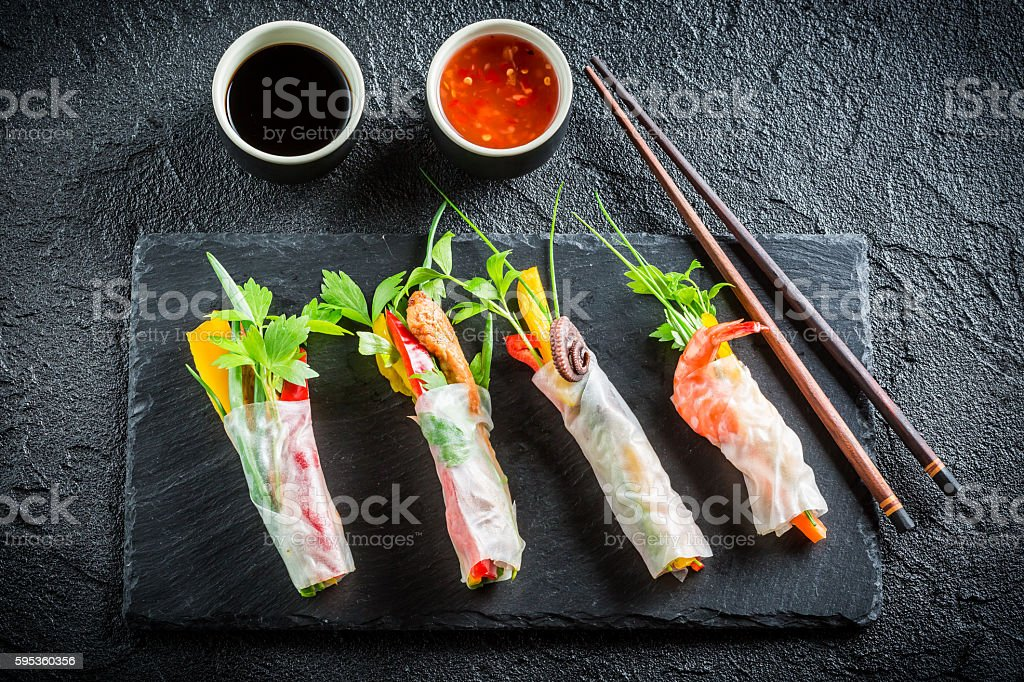Enjoy your spring rolls with seafood and vegetables stock photo