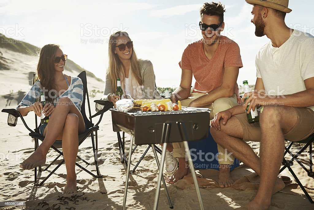 Enjoying a beach barbeque stock photo