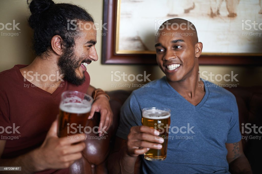 Enjoying a beer with my best friend stock photo
