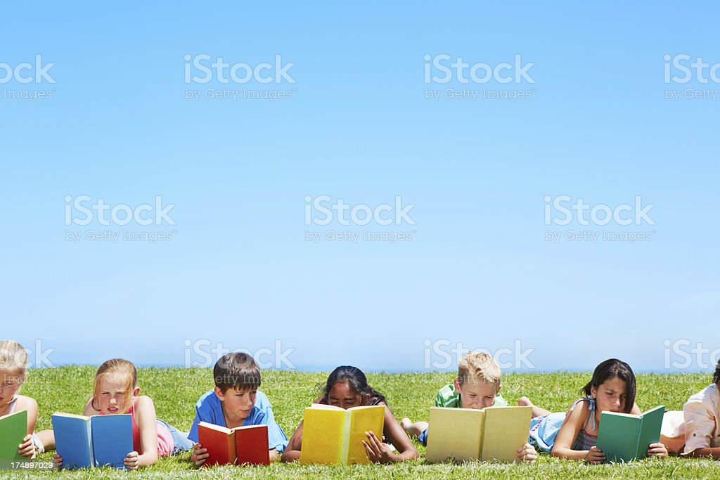 Enjoying a book in the park royalty-free stock photo
