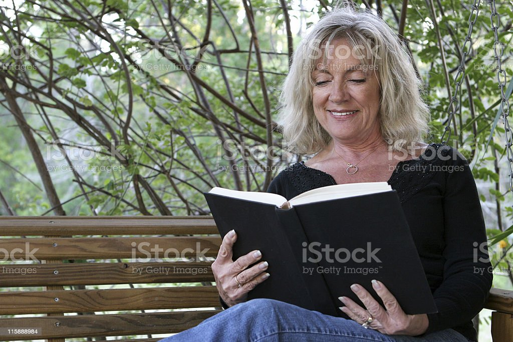 Enjoying A Book royalty-free stock photo