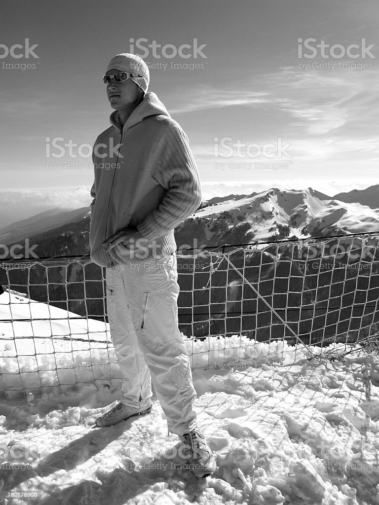Enjoying a cigarette after skiiing. stock photo