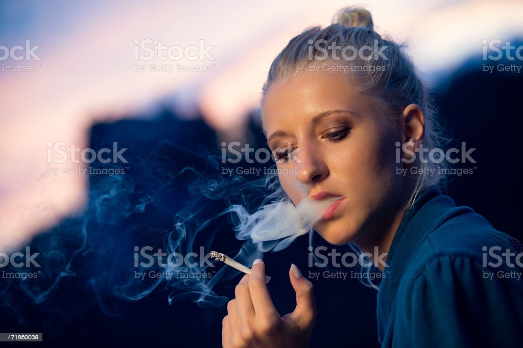 Enjoying a cigarette royalty-free stock photo
