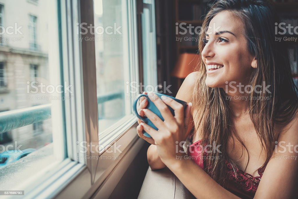 Enjoying a cup of coffee in the morning stock photo