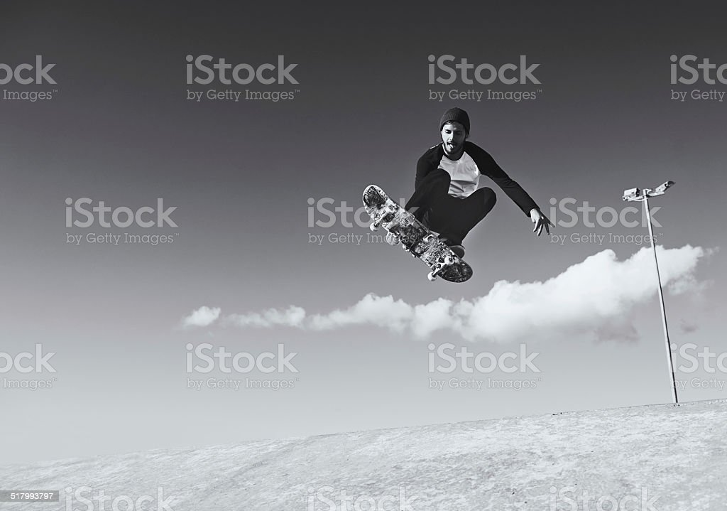 Enjoying a day at the skate park stock photo