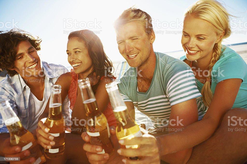 Enjoying a drink on the beach royalty-free stock photo