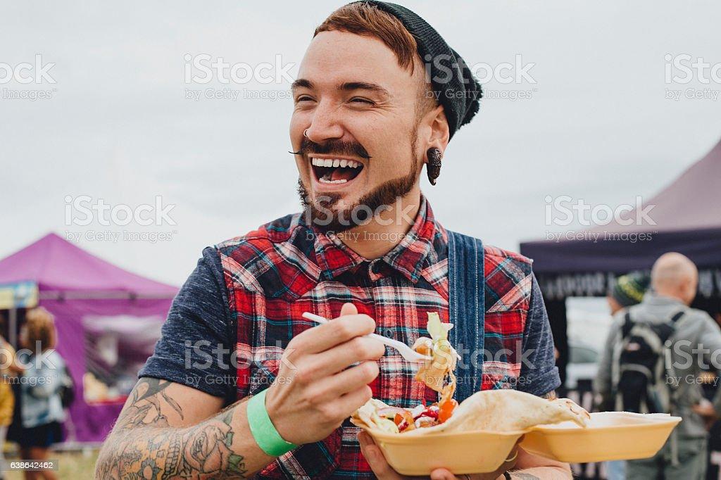 Enjoying A Festival Kebab stock photo