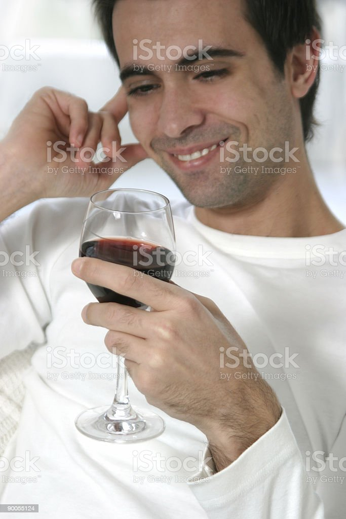 enjoying a glass of wine royalty-free stock photo