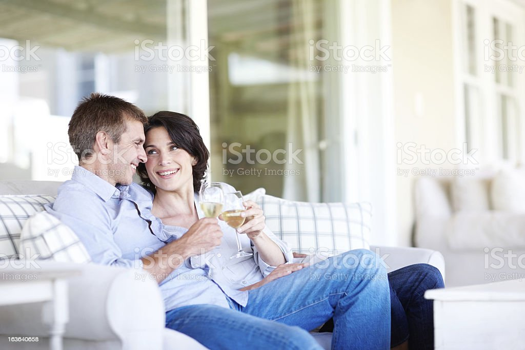 Enjoying a glass together royalty-free stock photo