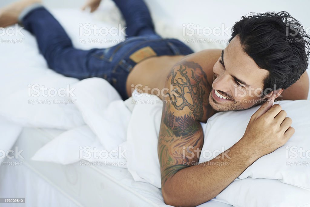 Enjoying a laugh in bed stock photo