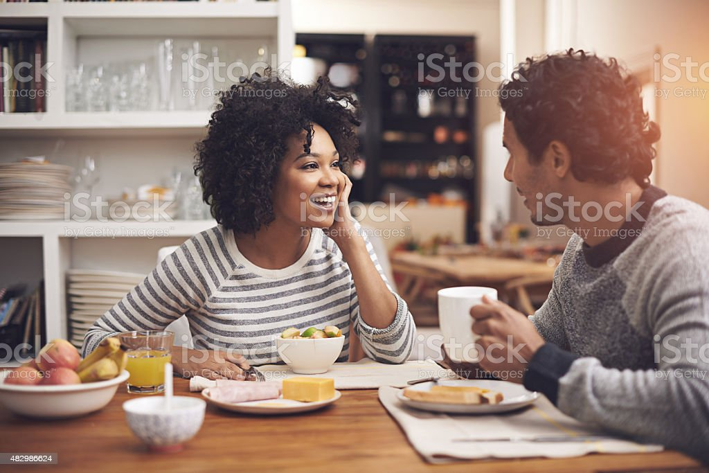 Enjoying a leisurely breakfast together stock photo