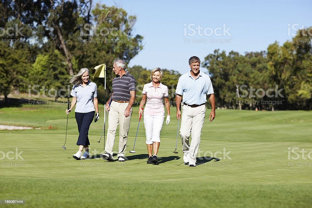 Enjoying a leisurely round of golf together royalty-free stock photo