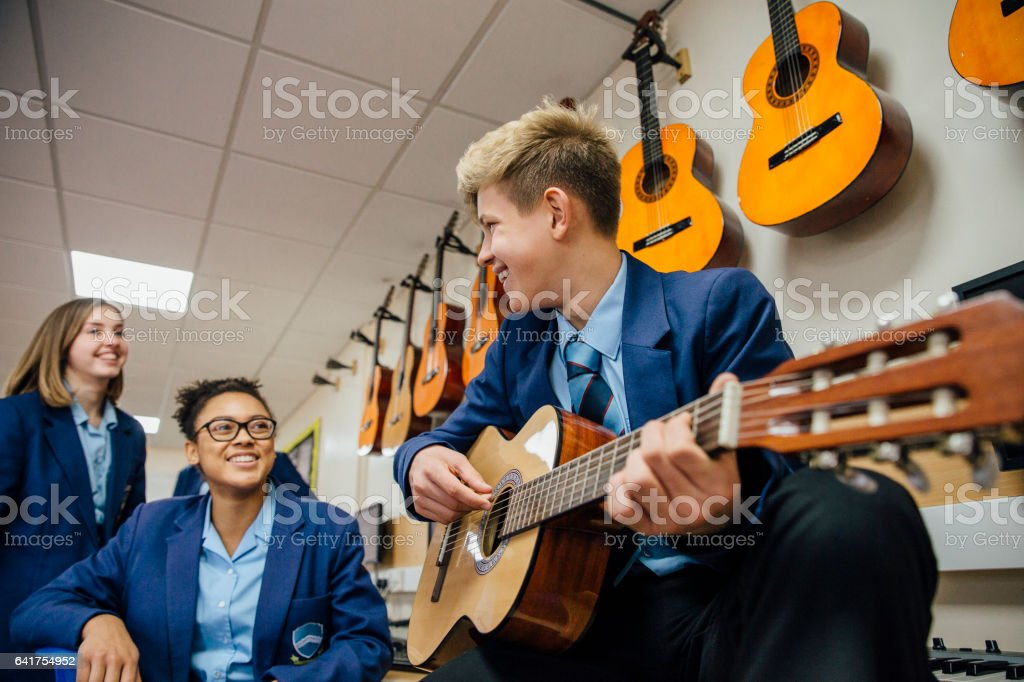 Enjoying A Music Lesson stock photo