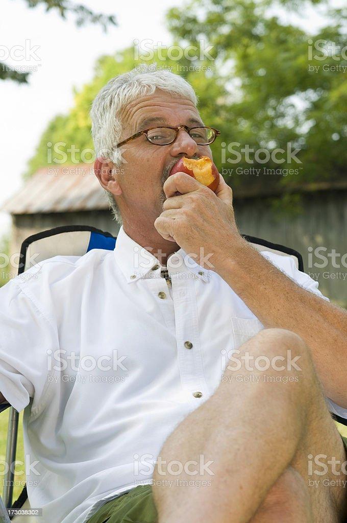 Enjoying a Nectarine stock photo