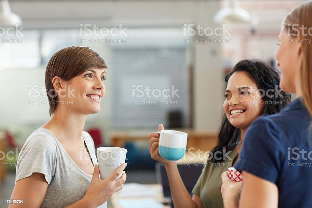 Enjoying a quick coffee break catch up stock photo