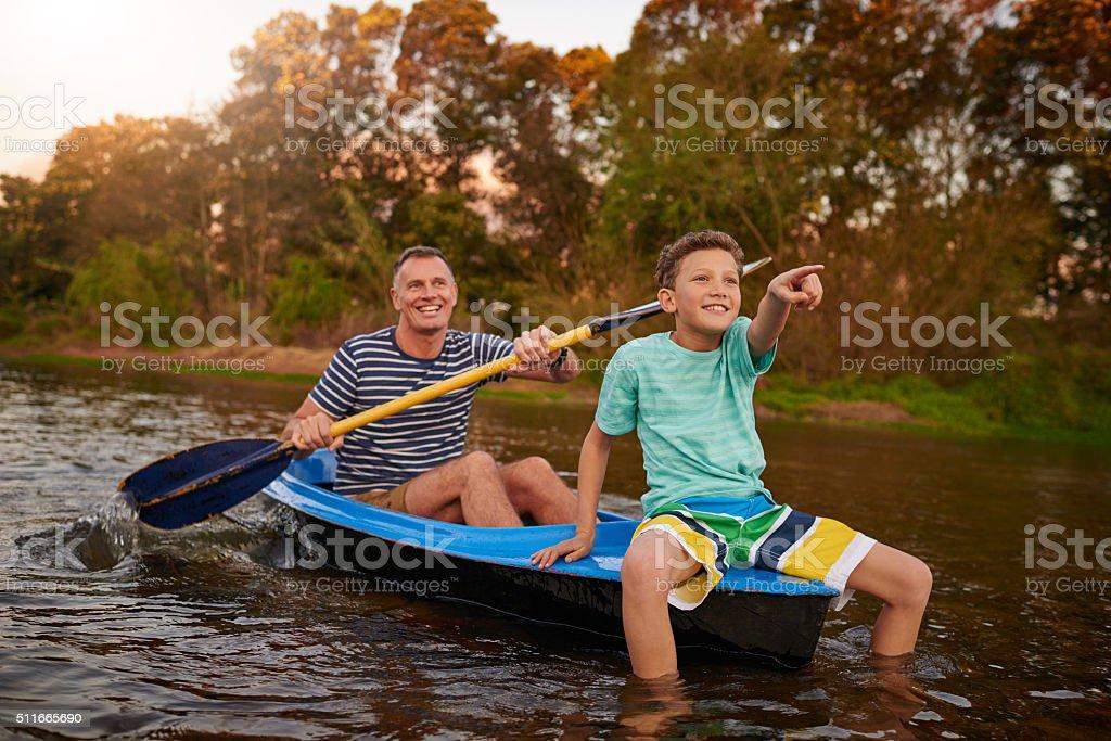 Enjoying a slow ride down river stock photo