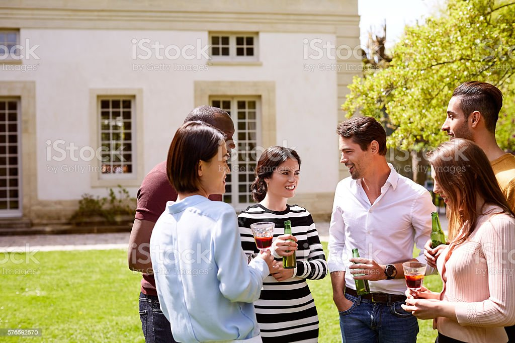 Enjoying a sunny afternoon with friends and refreshments stock photo