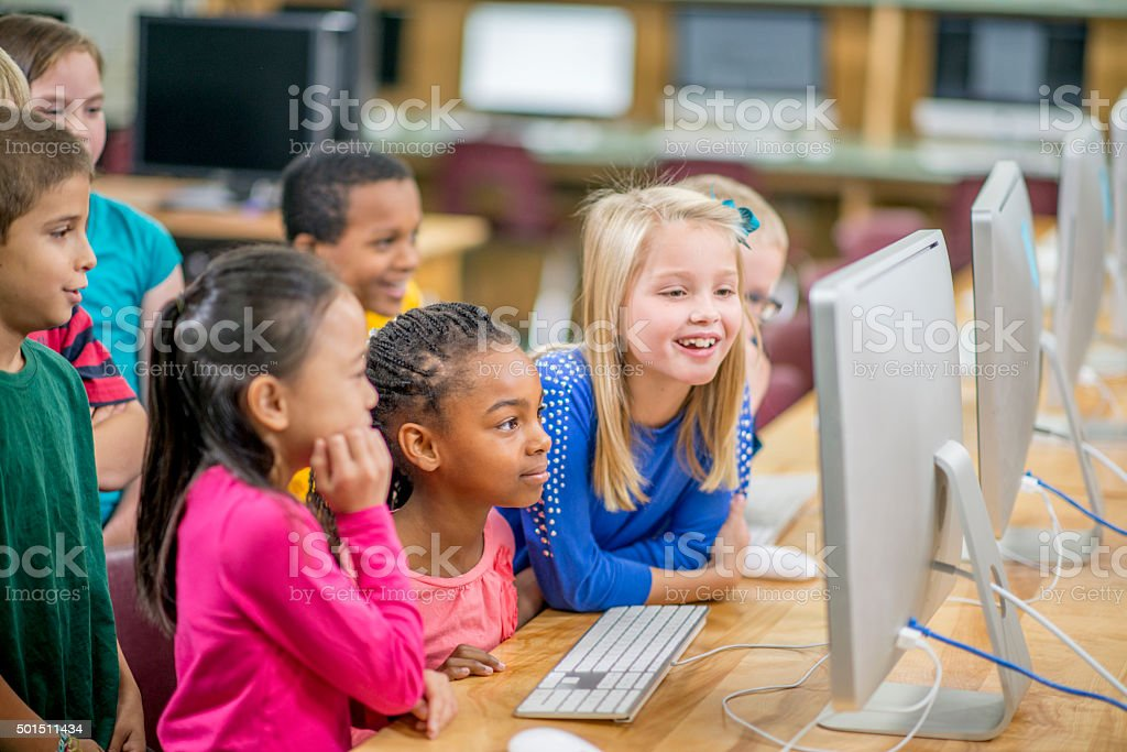 Enjoying a Video in the Computer Lab stock photo
