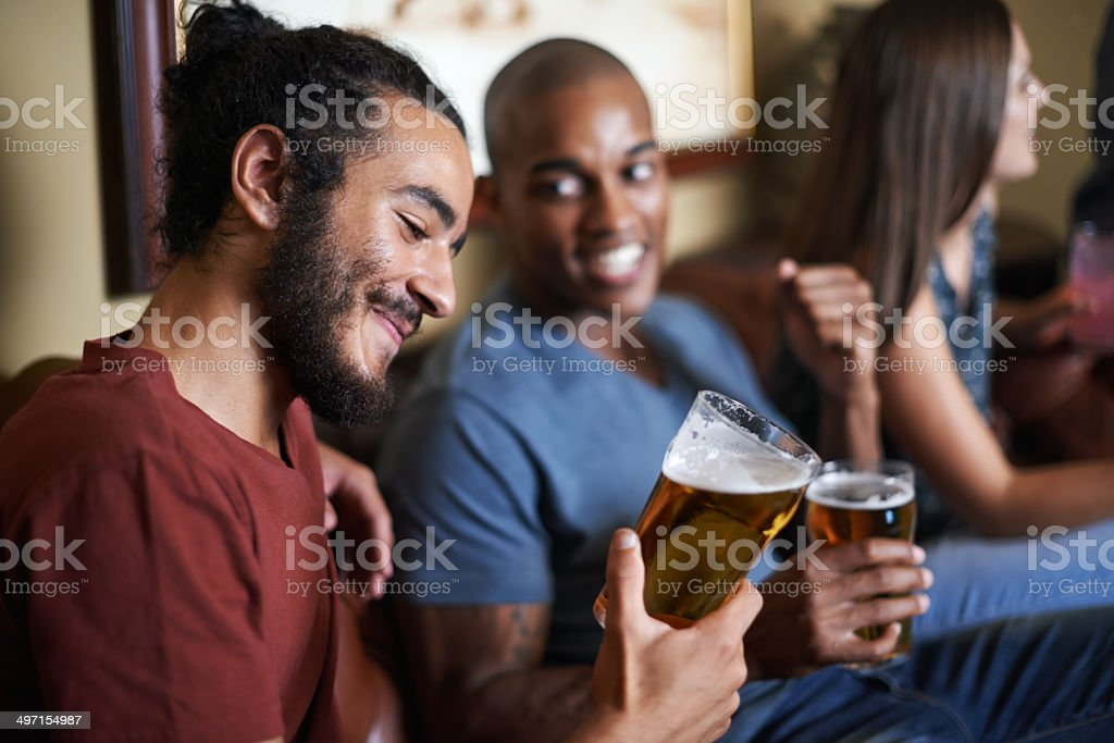 Enjoying a well earned beer after the long week stock photo