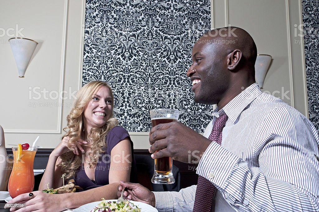 Enjoying an Evening Out in a Restaurant royalty-free stock photo