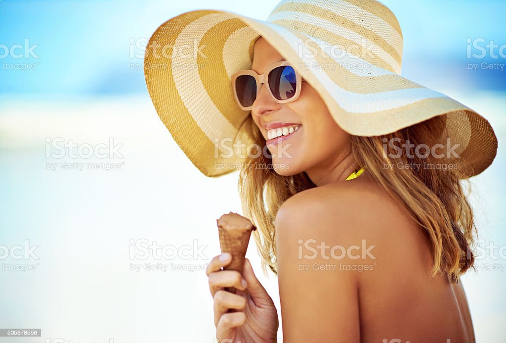 Enjoying an ice cream on the beach stock photo