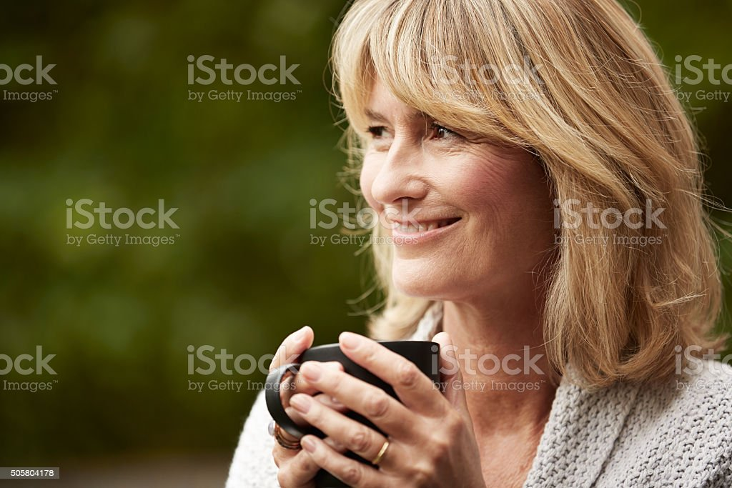 Enjoying an nice cuppa outside stock photo