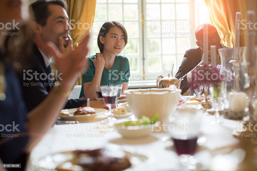 Enjoying and celebrating dinner together. stock photo