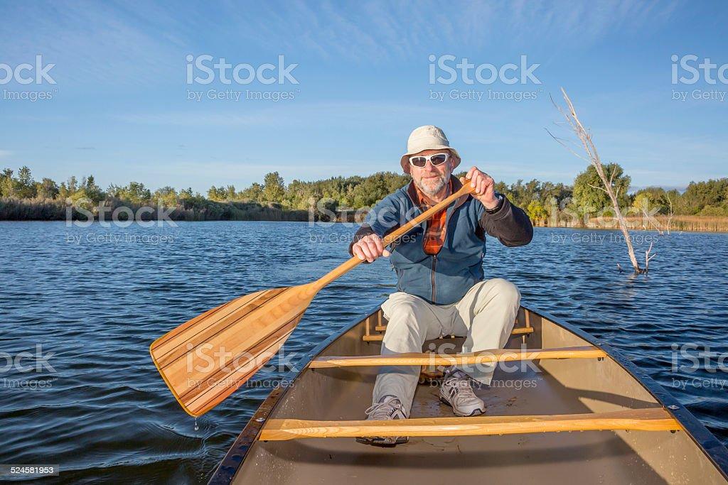 enjoying canoe paddling on lake stock photo