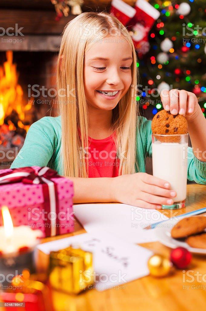 Enjoying Christmas cookies. stock photo
