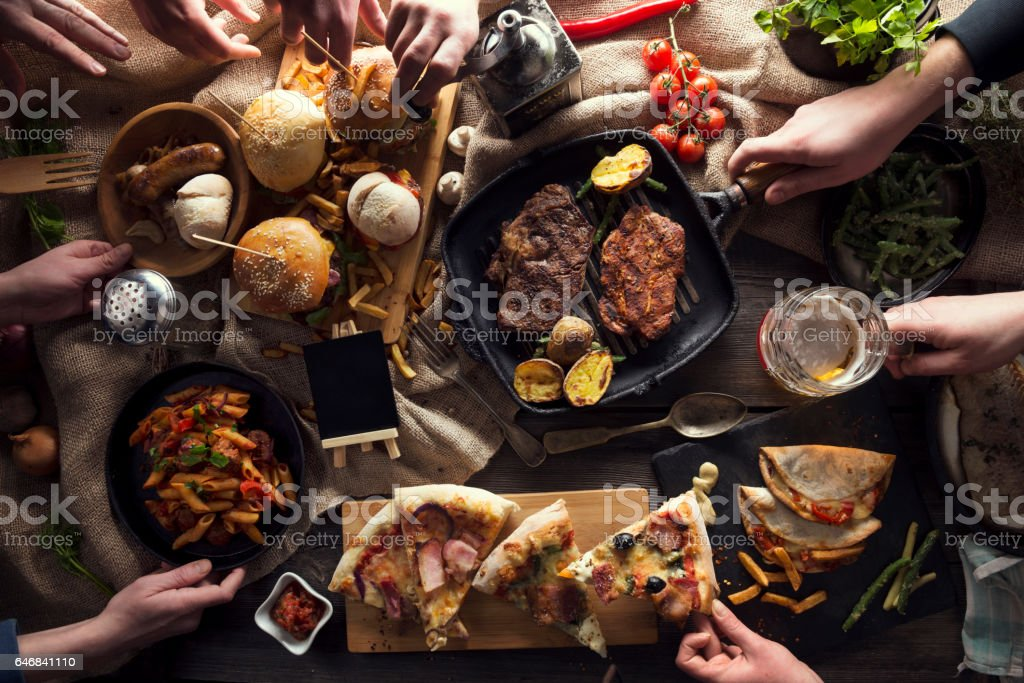 Enjoying dinner with friends stock photo