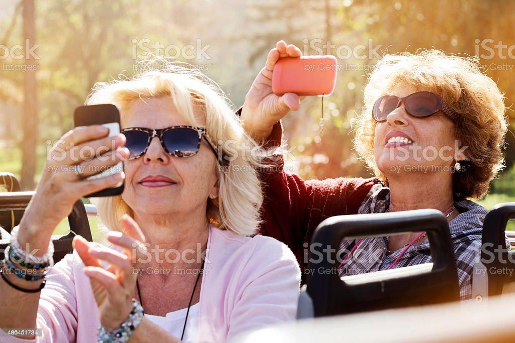 Enjoying Double-Decker Bus ride in city stock photo