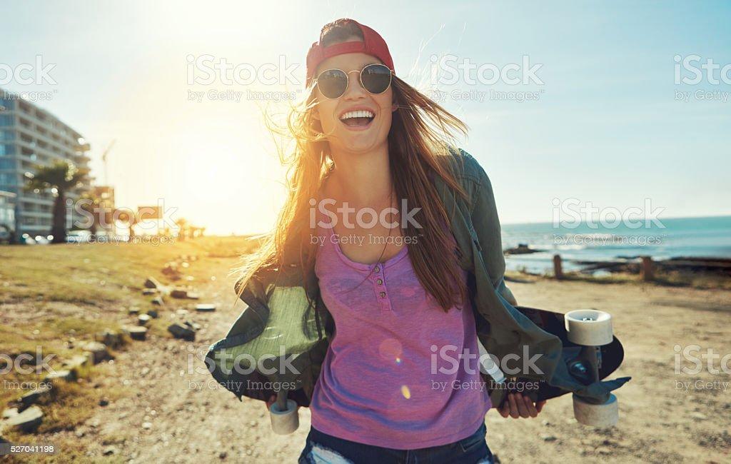 Enjoying every minute of summer skateboarding stock photo